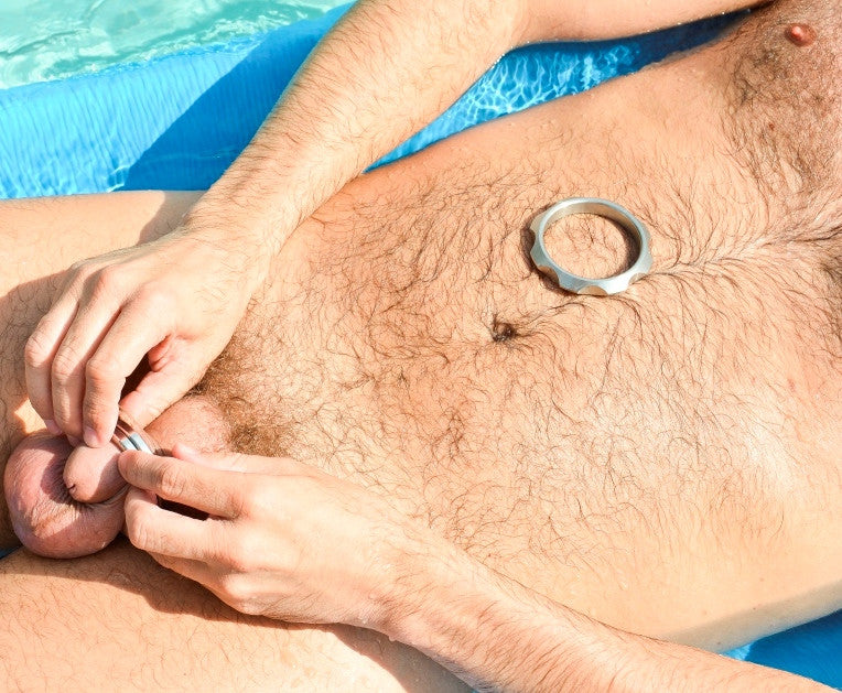 Puting on a cock ring