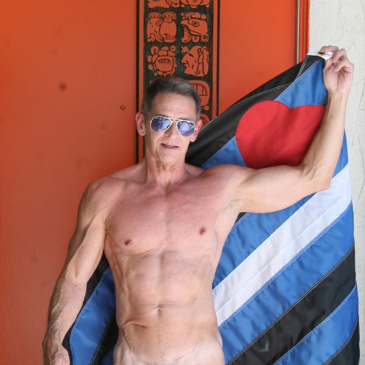Showing his Pride in the Hold Cock & Ball Cage