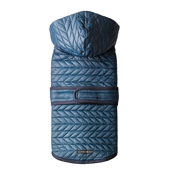 water repellent blue quilted nylon puffer dog winter jacket with a hood and harness hole opening