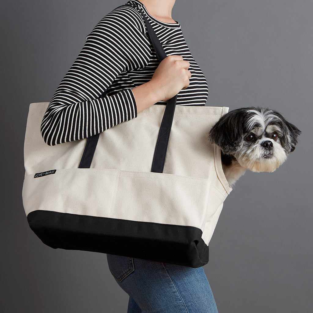 natural and black canvas dog carrier for airline travel