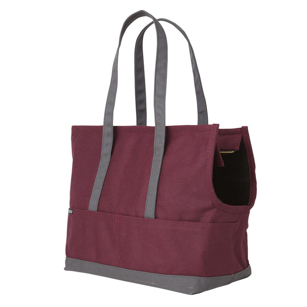 burgundy and dark grey canvas travel carrier for pets