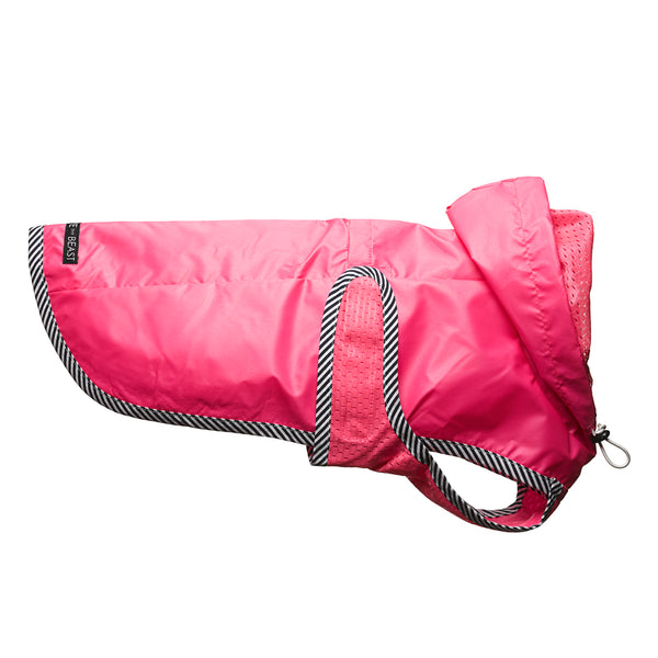 usa made sleek water repellent nylon dog jacket in neon pink with pink lining and striped trim with harness hole