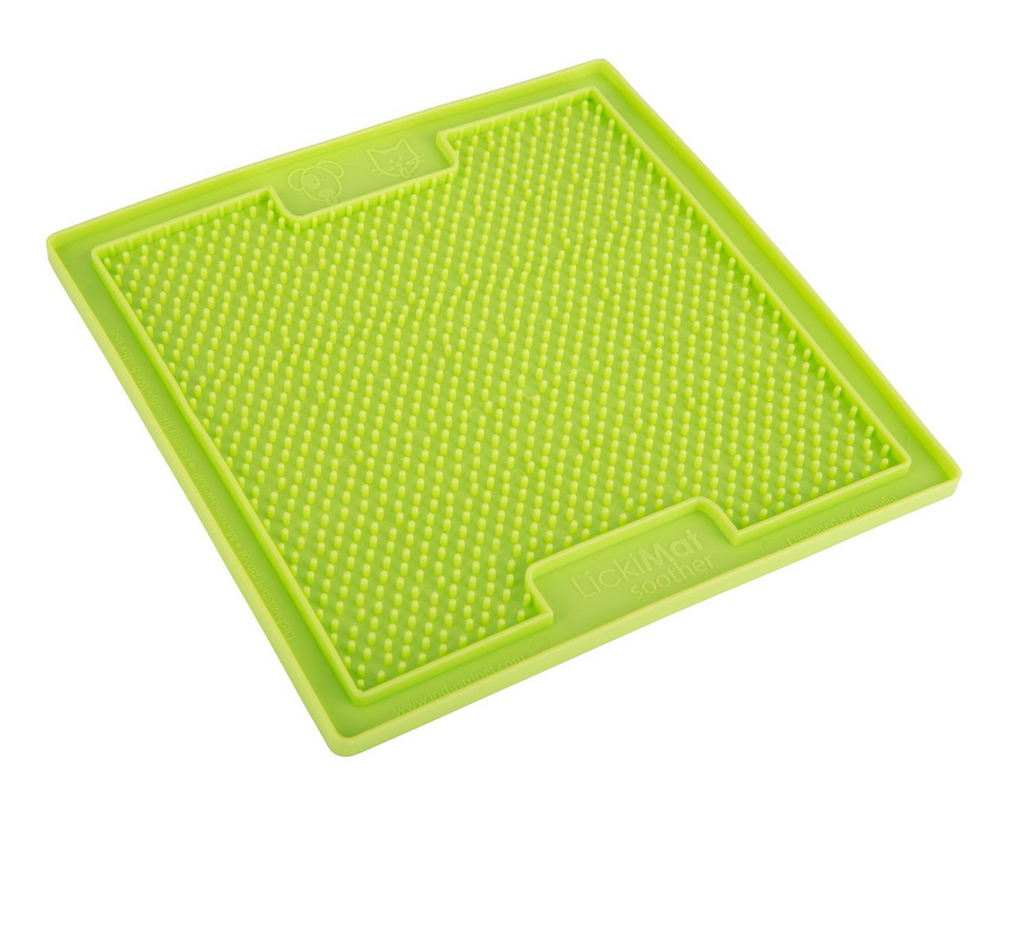 rubber mat toy with raised bumps for spreading treats for bored or anxious dogs