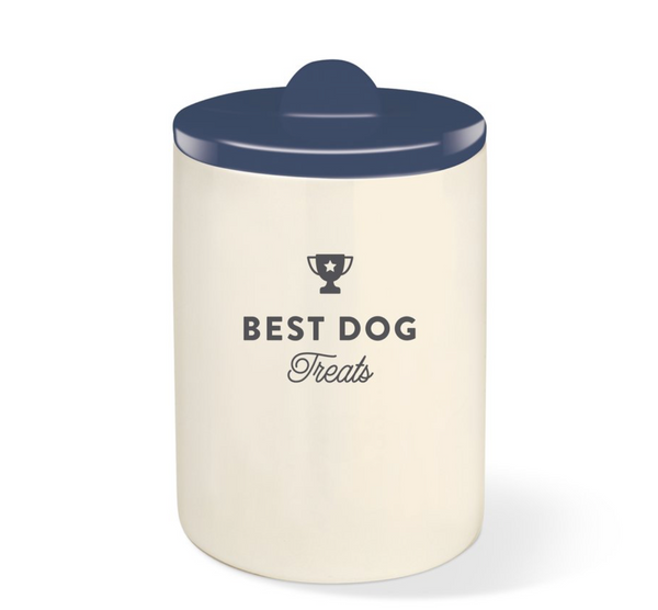 off white ceramic treat jar with best dog treats written and navy blue glazed lid with half moon shaped handle