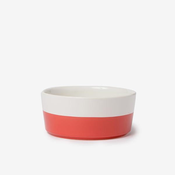 modern white weighted ceramic pet bowl with red hand dipped bottom