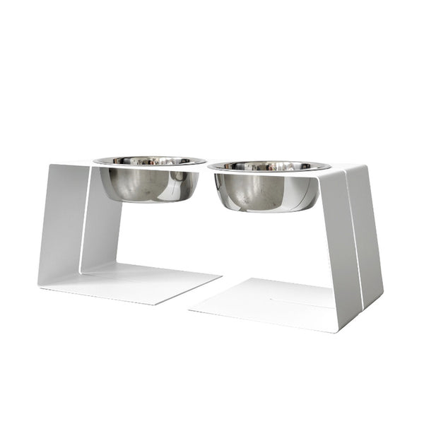 modern designer elevated pet food stand in white with two stainless steel bowls and silicone bumpers