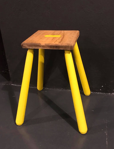 Vibrant yellow stool