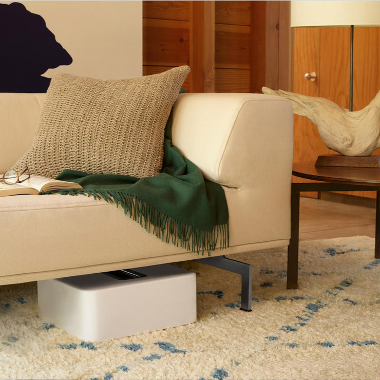 This subwoofer is so flexible in its placement options that it is placed under the sofa in this living rom