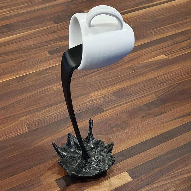 Spilling Coffee Cup Sculpture