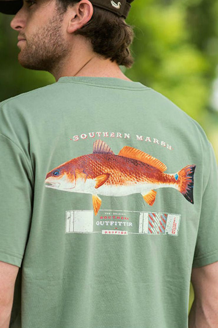 The Southern Marsh Outfitter Collection pays homage to the great outdoors with the Redfish -- one of the most popular sport fish in the United States. They are commonly known by several names: Red Drum, Channel Bass, Spot-Tail Bass or colloquially in the marshlands, simply as Reds. The Redfish's most distinguishing mark is a large, coin-sized, black spot on the upper part of the tail's base. The black spot near their tail helps fool predators into attacking the red drum's tail instead of their head, allowin