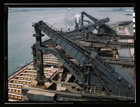 "Pennsylvania R.R. ore docks unloading ore from a lake freighter by means of ""Hulett"" unloaders Cleveland Ohio"