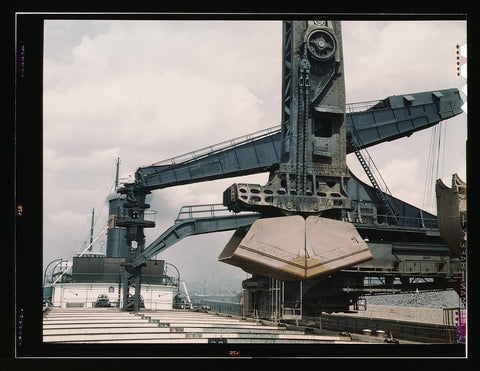 "Pennsylvania R.R. ore docks unloading iron ore from a lake freighter by means of ""Hulett"" unloaders Cleveland Ohio"