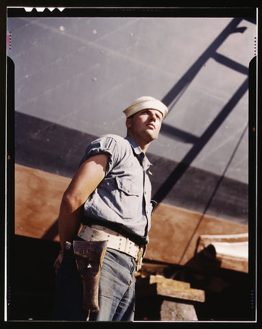 Coast Guardsman standing watch over 78-foot torpedo boat. Continual watch is kept. Higgins Industries Inc. New Orleans La.