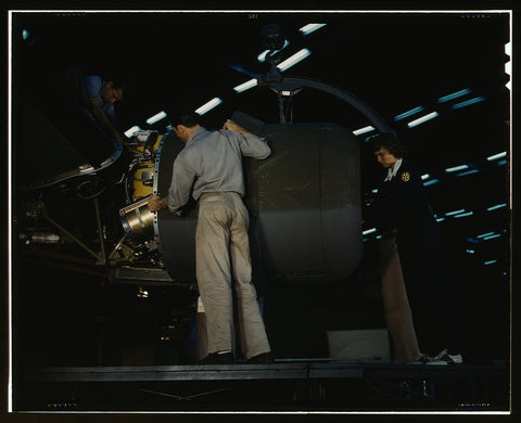 Lowering an engine in place in assembling a C-87 transport plane at the Consolidated Aircraft Corporation plant Fort Worth Texas