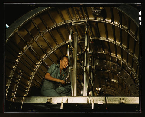Installing oxygen flask racks above the flight deck of a C-87 transport at the Consolidated Aircraft Corporation plant Fort Worth Texas
