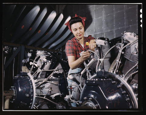 Woman working on an airplane motor at North American Aviation Inc. plant in Calif.