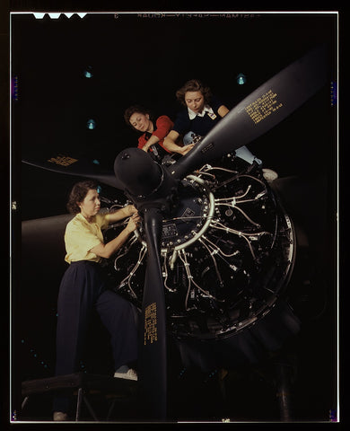 The careful hands of women are trained in precise aircraft engine installation duties at Douglas Aircraft Company Long Beach Calif.