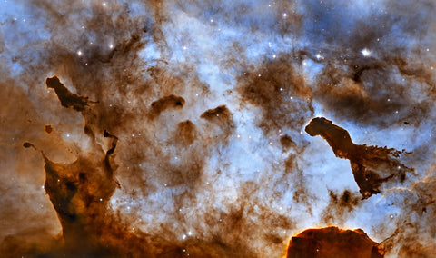 Cosmic Ice Sculptures: Dust Pillars in the Carina Nebula