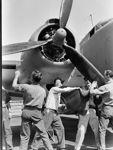 Checking finished PV-1 at the Vega aircraft plant  Burbank  Calif. Workmen spin propeller.  - 520736