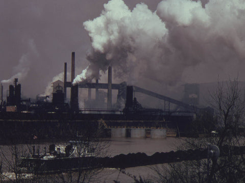 COAL BARGE ON THE MONONGAHELA RIVER MOVES PAST A UNITED STATES STEEL CORPORATION COKE PLANT AT CLAIRTON...  - 557216
