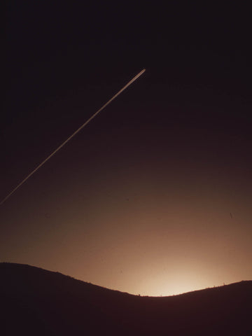 CONTRAIL AT DUSK. SEARCHLIGHT, NEVADA.