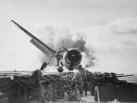Crash landing of F6F on flight deck of USS ENTERPRISE while enroute to attack Makin Island.