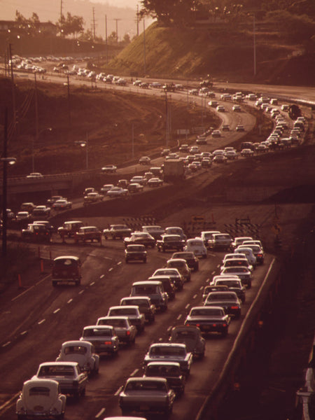 MORNING RUSH HOUR TRAFFIC ON H-1 FREEWAY APPROACHING HONOLULU FROM THE WEST.