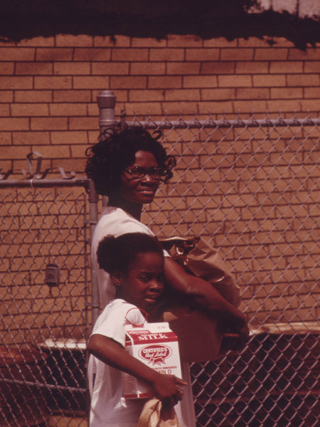 MOTHER AND DAUGHTER RETURNING HOME AFTER A GROCERY SHOPPING EXPEDITION IN CHICAGO'S WEST SIDE BLACK COMMUNITY.