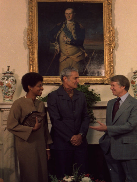 Mrs. Michael Manley, Prime Minister Michael Manley and Jimmy Carter during an Oval Office meeting.