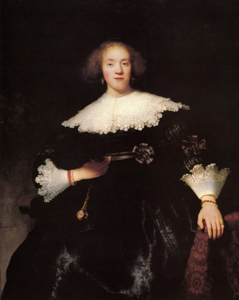 Portrait of a young woman with a fan by Rembrandt