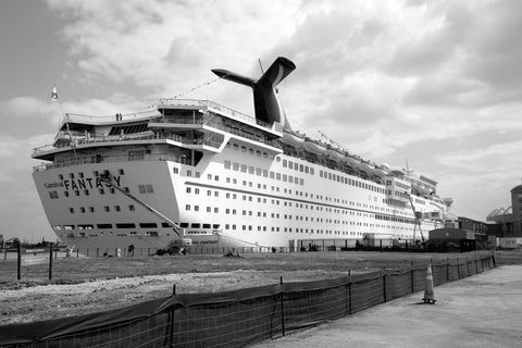 Large cruise ship picks up passengers at a loading dock a block away from downtown Mobile Alabama