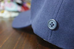 Hat with a button