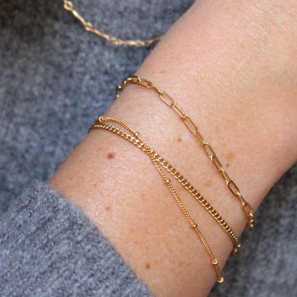 Fine Paperclip Chain Bracelet | Magpie Jewellery | Yellow Gold | On Model | Layered with Satellite and Curb Chain Bracelets