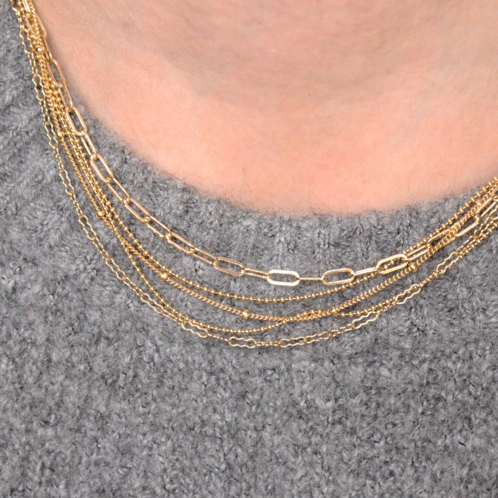 "Fine Paperclip Chain | Magpie Jewellery | Yellow Gold | On Model | Layered 16"" with Four Assorted Longer Chains"