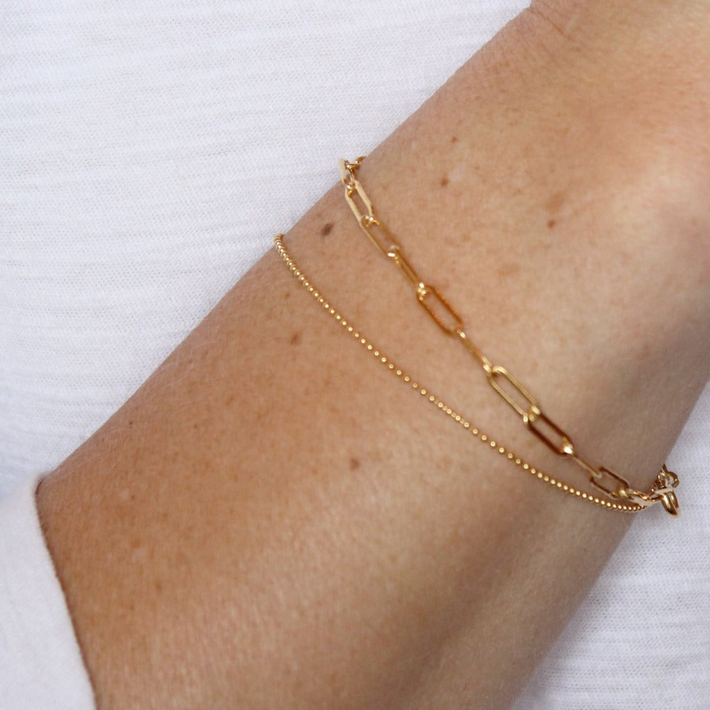 Tiny Ball Chain Bracelet | Magpie Jewellery | Yellow Gold | On Model | Layered with Fine Paperclip Bracelet