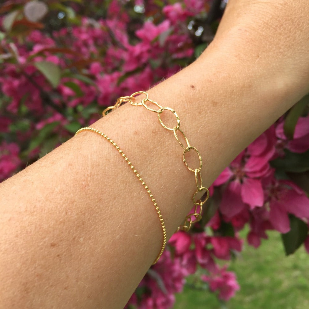 Tiny Ball Chain Bracelet | Magpie Jewellery | Yellow Gold | On Model | Layered With Hammered Oval Link Braceleet