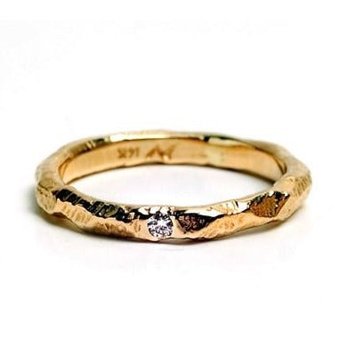 The Mountain Star ring by Anat Kaplan in 14kt yellow gold with .03ct diamond and hammered finish.