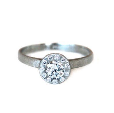 14kt white gold ring with a round brilliant diamond with a halo of diamonds and a textured finish
