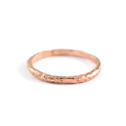 The Fine Seashore Band in 14kt rose gold with a textured finish.