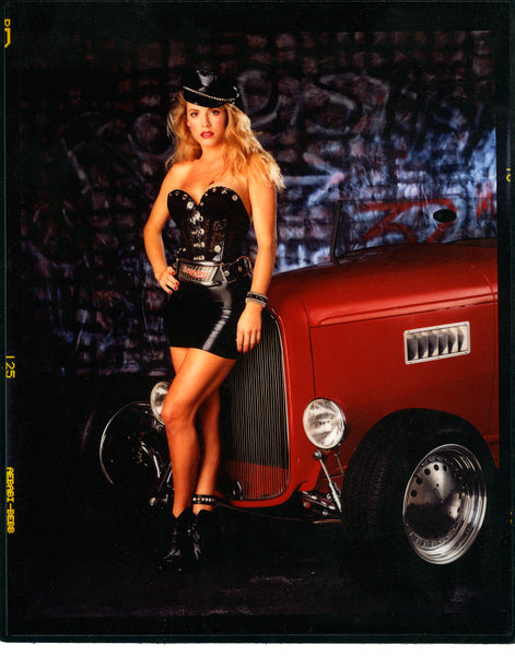 Girl in Leather Standing in Front of Hot Rod