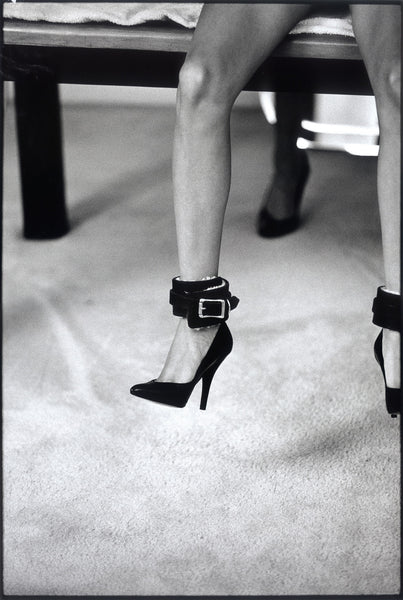 Girl's Legs with Leather Anklets and High Heels