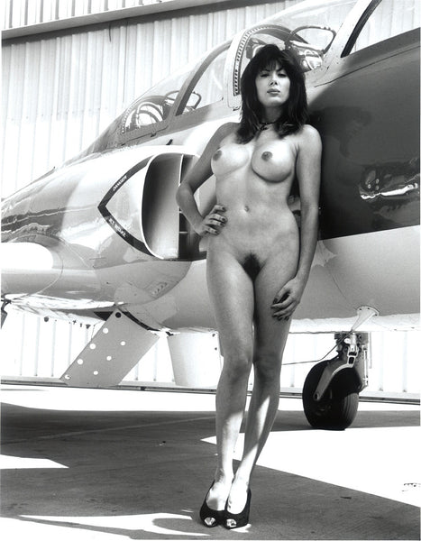 Nude Girl Standing Next to Jet Aircraft
