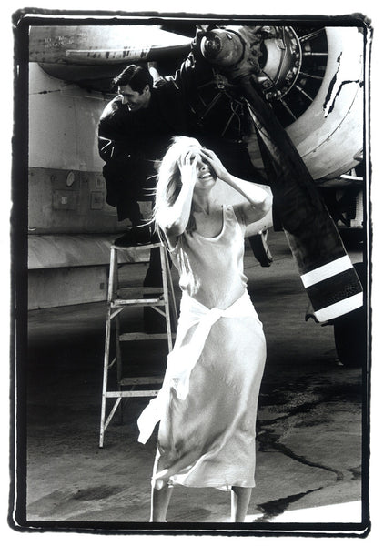 Girl Standing by Aircraft Engine