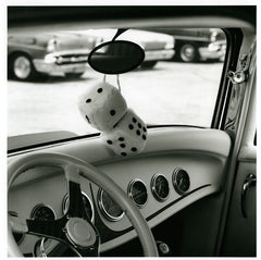 White Dice Hanging from Hot Rod With White Dash