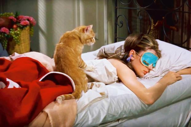 Audrey Hepburn sleeping. Does sleeping cause breakouts? Pillow hygiene via pimple patch brand ZitSticka