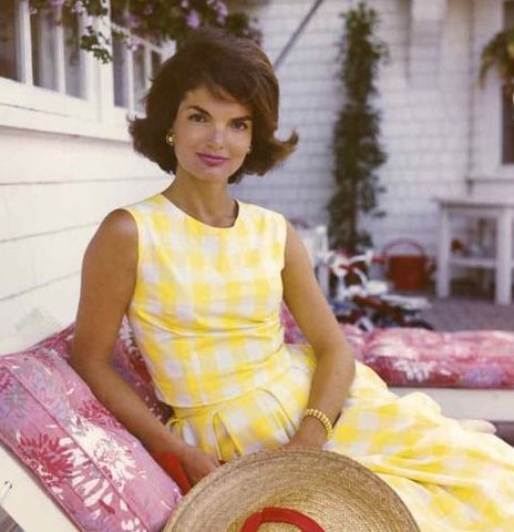 Jackie Kennedy outdoors wearing yellow sundress