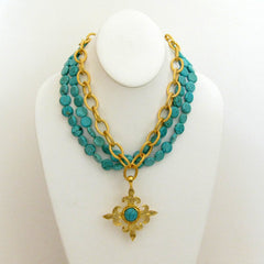 Gold Multi-Strand Turquoise Necklace with Fleur de Lis Pendant