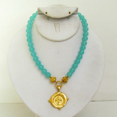 Gold Fleur de Lis on Aqua Quartz Necklace