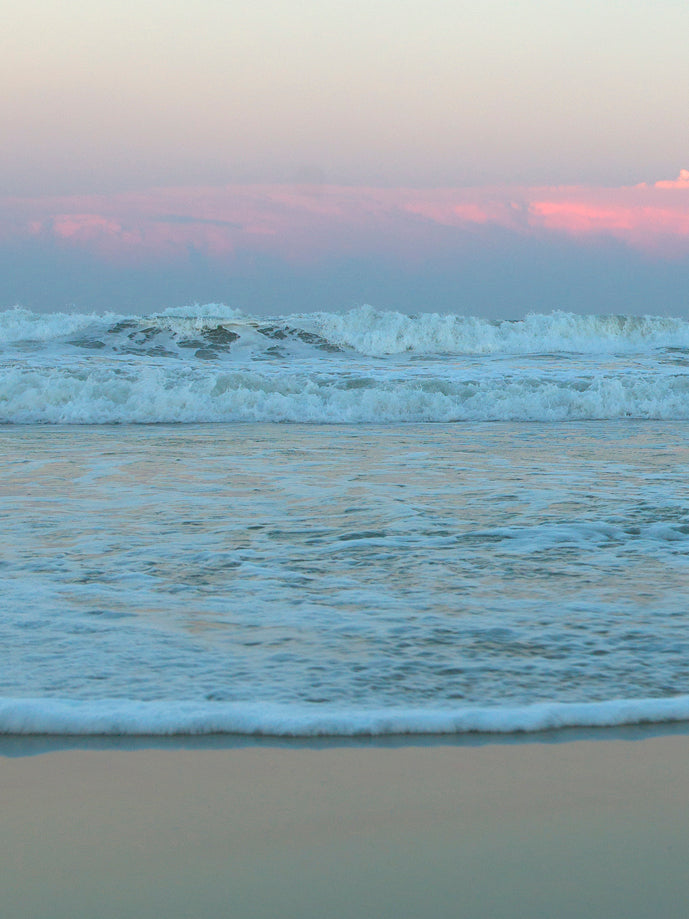 calm ocean, calm waves, pink ocean, blue and pink sunset, purple sunset, pink canvas wall art, pink sunset, beach canvas art, beach prints, carolina beach photos,