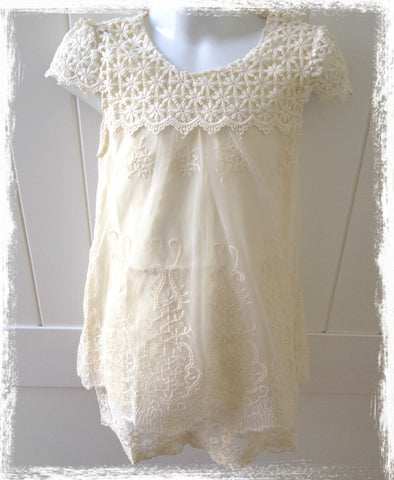 Ivory crochet and embroidered dress.